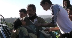 Samir 'Awad being evacuated from the scene after being shot, 15 January 2013. Photo: Nasar Mghar