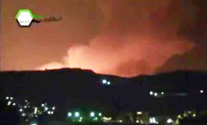 Smoke and fire fill the the skyline over Damascus early Sunday after an Israeli airstrike targeting a shipment of Iranian-made missiles believed to be on their way to Lebanon's Hezbollah group. (AP Photo/Ugarit News)