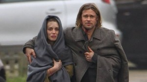 "Segen (Danielle Kertesz) with Brad Pitt in ""World War Z"" (photo credit: Courtesy)"