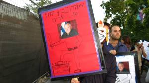 Poster showing 'Aharanovitch is brave when facing children'. theatrical protest, June 27th 2013. Photo: Guy Butavia.