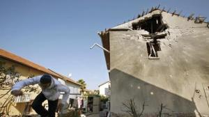 A Hamas rocket hit a house in Ashkelon, Israel, about 10 miles north of the Gaza Strip. A woman in the home was taken to the hospital for a panic attack. Carolyn Cole / Los Angeles Times