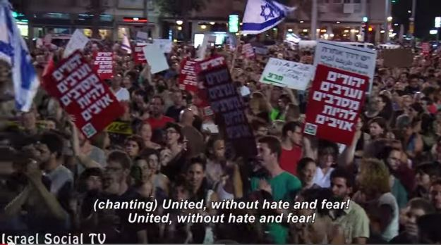 Placards at anti-Gaza war demonstration, Tel Aviv, July 26 2014. Still from video by Social TV.