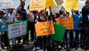 Demonstrators protesting against the planned evacuation of Bedouin villages in the Negev, June 11, 2015. Photo by Ilan Assayag